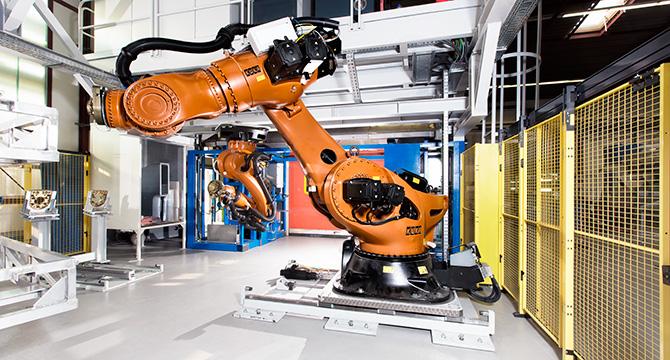 Dieses Industriefoto zeigt Roboter in der Automobilindustrie